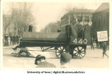 Locomotive-shaped float in Mecca Day parade, The University of Iowa, 1916