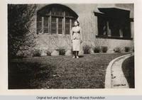 Arlene Friedlein in front of Grey house