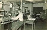 Geology students working in a laboratory, The University of Iowa, 1920s