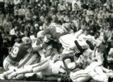 Pile-up of football players at the Homecoming game, 1985