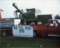 No-Till Plot Sign on Truck with Combine in Back