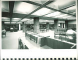 Students studying at tables in Main Library, the University of Iowa, 1972