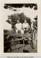 Couple seated in buggy