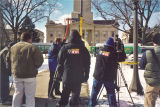 News crews filming replacement of Old Capitol dome, The University of Iowa, February 24, 2003