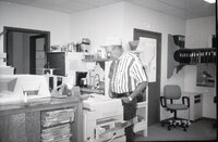 1995  John Horan stands at the photocopy machine