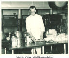 Chef preparing food at Centennial Dinner, Iowa Memorial Union, University of Iowa, February 25, 1947