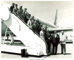 Republican campaign workers on stairs of airplane, Des Moines, Iowa, 1968