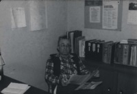Harold Brown reading in the office.