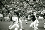 ISU quarterback throwing a pass during the Homecoming football game, 1985
