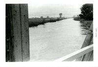 Otter Creek outside its banks during rainfall, 1965
