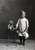 Boy with belt and teddy bear