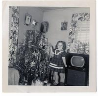 Darlene Oliver by Christmas Tree