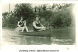 Students competing in women's annual canoe race, The University of Iowa, Memorial Day, 1923