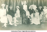 Actors seated on trunks in a theatrical production, The University of Iowa, ca. 1920