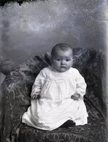 Infant in white dress