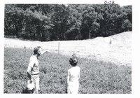 Lyle Felten and State clerk, Cathie Hartvigsen on Felten farm, 1967