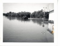 Flood waters surrounding Gulf gas station, 1969