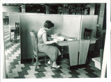 Women working in study carrel in Main Library, the University of Iowa, 1955