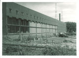 Dismantiling part of Main Library's south wall to add first addition, the University of Iowa, 1961