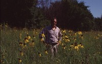Eric Hoien Poses in Native CRP Field.