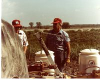 Two Farmers Setting Up Till Spraying