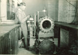 Student with scientific equipment, The University of Iowa, 1930s?