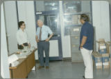 Earl O. Heady with Somnuk Sriplung and another official at the Office of Agricultural Economics in Bangkok, Thailand, 1983