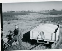 Wm. Vinzant and shelled corn in a trailer from his land, 1966