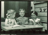Girls seated at activity table, The University of Iowa, 1940s