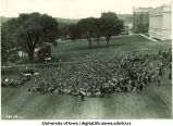 Induction ceremony on southwest side of Pentacrest, The University of Iowa, 1920s