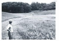 Lyle Felton observing new grass waterway, 1966