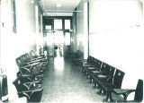 Seats from Zoology Building room 201 displaced for renovations and stacked in 2nd floor hallway, The University of Iowa, 1982