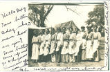 Young women with aprons posing outside, Tabor, Iowa, August 8, 1906