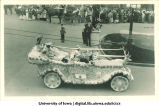 Young women in decorated automobile in parade, The University of Iowa, 1910s