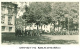 Academic procession heading south on Pentacrest, The University of Iowa, 1920s?