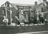 "Homecoming lawn display, """"Take 'em one by one 'n win the rest,"""" 1962"