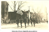 Soldiers marching in Mecca Day parade, The University of Iowa, 1918