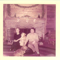 Frindy, John, Sr. and corgies sitting on fire place hearth