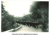 Commencement procession walking west on path near Field House, The University of Iowa, 1940s