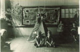 Classroom with tipi and students dressed as Native Americans, The University of Iowa, 1920s