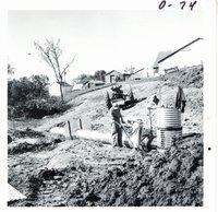 Installing pipe spillway on Harvey Michel land, 1968