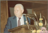 Earl O. Heady standing behind a lectern