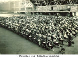 Students taking exam in Armory, The University of Iowa, 1920s