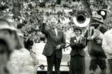 President Parks waving at Homecoming, 1985