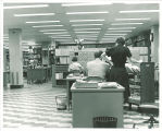 People working in the Acquisitions Department of Main Library, the University of Iowa, April 1970