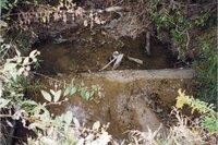 1999 - Weir in feeder creek under gravel road