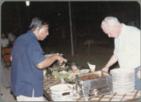 Earl O. Heady in a buffet line during his visit to Thailand, April 1983