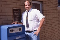 Jeff Lunquist in front of the Cherokee Daily Times.
