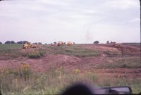 Bulldozers working field
