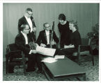 Iowa Woodwind Quintet looking at sheet music, The University of Iowa, 1968